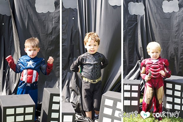 Superhero Birthday Party: Danger Room: Obstacle Course: Posing in front of Superhero backdrop
