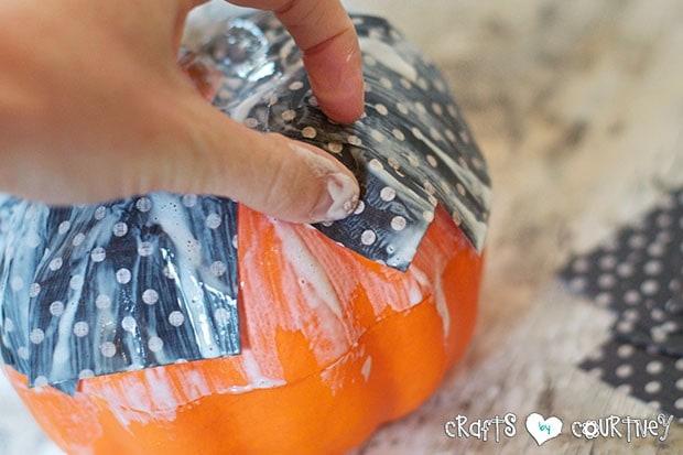 Mod Podge Pumpkins:  Press Down Your Scrapbook Paper