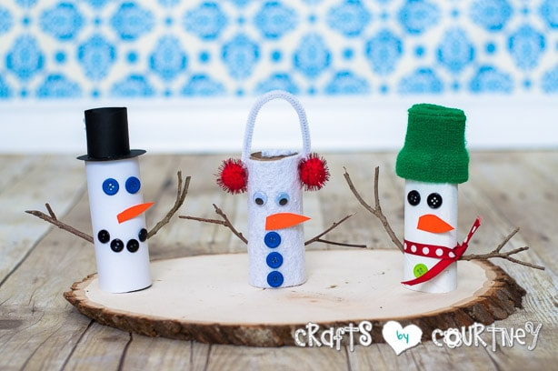 Christmas Craft: Toilet Paper Roll Snowmen: We used Cardstock, Felt and Paint to create our snowmen