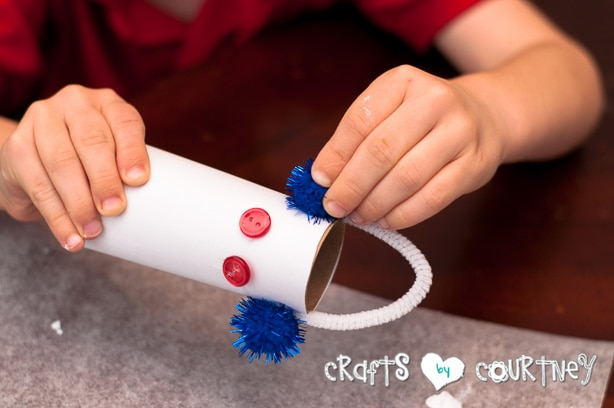 Christmas Craft: Toilet Paper Roll Snowmen: Add Your Pom Pom Ball for the Ear Muffs