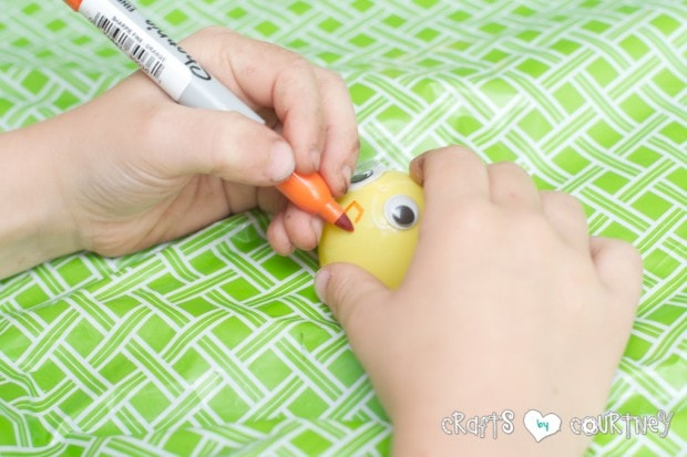 Plastic Easter Egg Chicks in a Shredded Paper Nest Craft for Kids: Draw on your beak